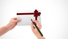 Σύνθετη εικόνα των χεριών που κρατά την κάρτα και τη μάνδρα Στοκ Εικόνα