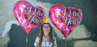 Σύνθετη εικόνα των geeky μπαλονιών εκμετάλλευσης hipster Στοκ Εικόνα