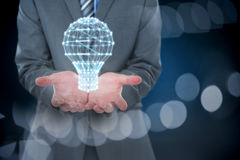 Σύνθετη εικόνα midsection του επιχειρηματία που κρατά το αόρατο αντικείμενο στοκ φωτογραφίες