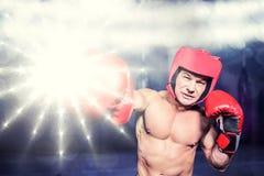Σύνθετη εικόνα punching μπόξερ στο μαύρο κλίμα Στοκ φωτογραφία με δικαίωμα ελεύθερης χρήσης