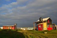 Σύννεφα και σπίτια σε Cabo Polonio Στοκ Φωτογραφία