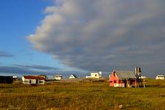 Σύννεφα και σπίτια σε Cabo Polonio Στοκ Φωτογραφίες