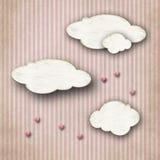 Σύννεφα χαρτονιού στο ριγωτό υπόβαθρο Στοκ Φωτογραφίες
