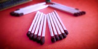 Σύνολα Matchstick με την όμορφη φωτογραφία αποθεμάτων παρουσίασης στοκ εικόνες