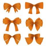 Σύνολο διαφορετικών πορτοκαλιών τόξων για τη διακόσμηση Ντεκόρ για την ημέρα, τα γενέθλια, το γάμο, τους εορτασμούς και τις διακο διανυσματική απεικόνιση