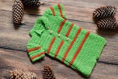 Σύνολο Χριστουγέννων ενδυμάτων για έναν βλαστό φωτογραφιών ενός νεογέννητου Στοκ Εικόνες