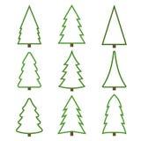 Σύνολο χριστουγεννιάτικων δέντρων περιγράμματος σε ένα άσπρο υπόβαθρο στοκ εικόνα