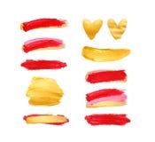 Σύνολο χρυσών και κόκκινων κτυπημάτων που απομονώνονται στο άσπρο υπόβαθρο Σφαίρα κραγιόν που λεκιάζεται Όμορφα κατασκευασμένα κτ στοκ εικόνες