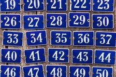 Σύνολο αυξάνοντας αριθμών πινακίδας αυτοκινήτου σπιτιών Στοκ Εικόνες
