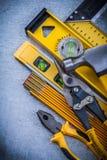 Σύνολο εργαλείων κατασκευής γρατσουνισμένο σε μεταλλικό Στοκ Εικόνες