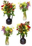 Σύνολο δεσμών των λουλουδιών στις κανάτες στο λευκό Στοκ φωτογραφίες με δικαίωμα ελεύθερης χρήσης