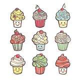 Σύνολο ζωηρόχρωμων γλυκών cupcakes στο άσπρο υπόβαθρο Απεικόνιση αποθεμάτων
