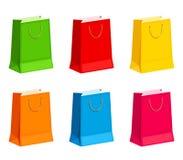 Σύνολο ζωηρόχρωμων τσαντών δώρων ή αγορών επίσης corel σύρετε το διάνυσμα απεικόνισης Στοκ Εικόνα
