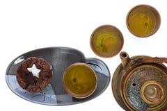 Σύνολο κατανάλωσης σοκολάτας και τσαγιού κέικ φλυτζανιών Στοκ Εικόνες