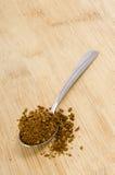 Σύνολο κουταλιών του στιγμιαίου καφέ στο ξύλο Στοκ Εικόνες