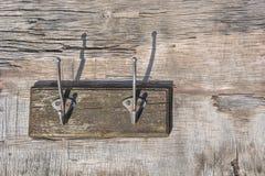Σύνολο κρεμάστρας του τοίχου γάντζων χάλυβα Στοκ Φωτογραφίες