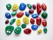 Σύνολο προσώπων χαμόγελου των τεράτων Αστεία χρωματισμένα ακρυλικά χαλίκια Στοκ εικόνες με δικαίωμα ελεύθερης χρήσης