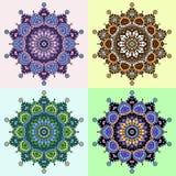 Σύνολο τεσσάρων χρωματισμένων εκδόσεων ενός σχεδίου mandala Στοκ Εικόνες