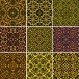 Σύνολο χρυσών Floral άνευ ραφής σχεδίων για το ύφασμα ή το κλωστοϋφαντουργικό προϊόν des Στοκ Φωτογραφίες