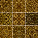 Σύνολο χρυσών Floral άνευ ραφής σχεδίων για το ύφασμα ή το κλωστοϋφαντουργικό προϊόν Στοκ Εικόνα