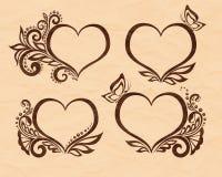 Σύνολο όμορφου γραπτού συμβόλου μιας καρδιάς με το floral σχέδιο και την πεταλούδα Τελειοποιήστε για τις ευχετήριες κάρτες υποβάθ Στοκ Φωτογραφία