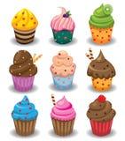 Σύνολο Cupcakes που απομονώνεται στο άσπρο υπόβαθρο διανυσματική απεικόνιση
