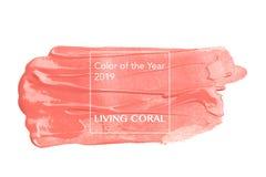 Σύσταση βουρτσών και χρωμάτων στο κοράλλι διαβίωσης εγγράφου Χρώμα του έτους 2019 στοκ εικόνες