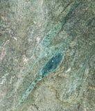 Σύσταση βράχου με το πράσινο σχέδιο Στοκ φωτογραφία με δικαίωμα ελεύθερης χρήσης