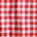Σύσταση ενός κόκκινου και άσπρου ελεγμένου καλύμματος πικ-νίκ στοκ φωτογραφίες