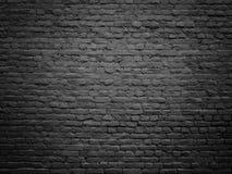 Σύσταση ενός μαύρου τουβλότοιχος, σκοτεινό υπόβαθρο για το σχέδιο Στοκ Εικόνα