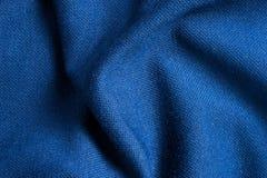 Σύσταση και υπόβαθρο του μπλε υφάσματος πολυεστέρα τόσο όμορφου Στοκ Φωτογραφίες