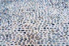 σύσταση πετρών προσόψεων λεπτομέρειας ανασκόπησης αρχιτεκτονικής Σύσταση των στρογγυλών πετρών στο τσιμέντο Στοκ Φωτογραφίες