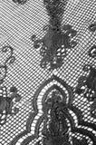 Σύσταση, σχέδιο Το ύφασμα δαντελλών είναι γκρίζο, γραπτός άθλος Στοκ Εικόνες