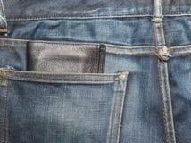 Σύσταση τζιν, μπλε τζιν τζιν με το μαύρο πορτοφόλι lether Στοκ Φωτογραφία