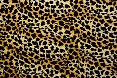 Σύσταση της λεοπάρδαλης λωρίδων υφάσματος τυπωμένων υλών για το υπόβαθρο Στοκ Φωτογραφίες