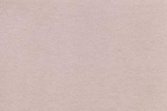 Σύσταση της παλαιάς μπεζ κινηματογράφησης σε πρώτο πλάνο εγγράφου Δομή ενός πυκνού χρώματος άμμου χαρτονιού εθνικό verdure ανασκό Στοκ Εικόνα