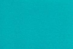 Σύσταση της παλαιάς τυρκουάζ κινηματογράφησης σε πρώτο πλάνο εγγράφου Δομή ενός πυκνού χαρτονιού Το μπλε υπόβαθρο Στοκ εικόνα με δικαίωμα ελεύθερης χρήσης