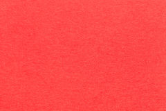 Σύσταση της παλαιάς φωτεινής κόκκινης κινηματογράφησης σε πρώτο πλάνο εγγράφου Δομή ενός πυκνού χαρτονιού Το υπόβαθρο καρμινίου Στοκ Εικόνες