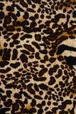 Σύσταση της ριγωτής λεοπάρδαλης υφάσματος τυπωμένων υλών για το υπόβαθρο Στοκ Φωτογραφίες