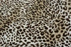 Σύσταση της ριγωτής λεοπάρδαλης υφάσματος τυπωμένων υλών για το υπόβαθρο Στοκ εικόνα με δικαίωμα ελεύθερης χρήσης