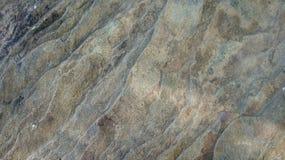 Σύσταση του γκρίζου καφετιού υποβάθρου πετρών στοκ φωτογραφία
