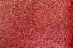 Σύσταση του γνήσιου δέρματος που επισημαίνεται, που χρωματίζεται, με τη ρυτίδα, την πτυχή, κόκκινο καφετί χρώμα, επιφάνεια υποβάθ στοκ εικόνες με δικαίωμα ελεύθερης χρήσης