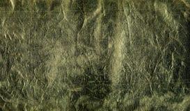 Σύσταση του διακοσμητικού δέρματος Σκοτεινή χρυσή, καφετιά επιφάνεια με τα ίχνη γήρανσης, χρήση, ζουλίγματα, γρατσουνιές Πρότυπο  ελεύθερη απεικόνιση δικαιώματος
