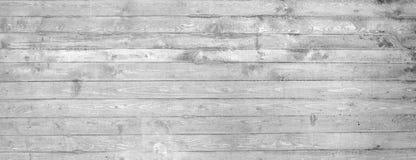 Σύσταση του ξύλινου εγκιβωτισμού που σφραγίζεται σε έναν ακατέργαστο συμπαγή τοίχο Στοκ Φωτογραφία