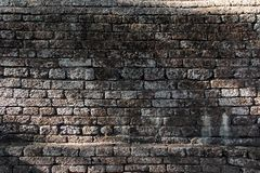 Σύσταση του παλαιού καφετιού laterite εκλεκτής ποιότητας τοίχου πετρών Στοκ Εικόνες