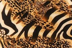 Σύσταση του ριγωτών με ραβδώσεις και της λεοπάρδαλης υφάσματος τυπωμένων υλών Στοκ φωτογραφίες με δικαίωμα ελεύθερης χρήσης