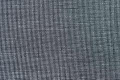 Σύσταση του σκούρο γκρι υφάσματος πουκάμισων με τον άσπρο πυροβολισμό κινηματογραφήσεων σε πρώτο πλάνο κουμπιών ελεύθερη απεικόνιση δικαιώματος
