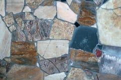 Σύσταση του τοίχου με την καθορισμένη πέτρα μωσαϊκών Στοκ Εικόνες