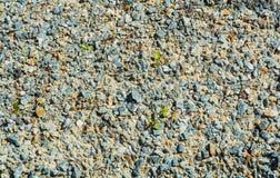 Σύσταση των γκρίζων και κίτρινων μικρών πετρών Στοκ Φωτογραφίες