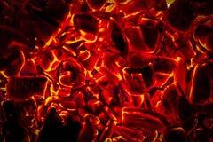 Σύσταση υποβάθρου κινηματογραφήσεων σε πρώτο πλάνο ανθρακόπλινθων ξυλάνθρακα πυράκτωσης καυτή στοκ φωτογραφία